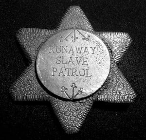 Slave patrol badge
